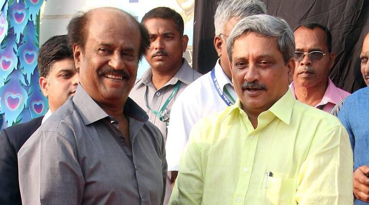 """Addressing Rajnikanth with a sheepish smile, Parrikar said: """"Sorry for that goof. I had written (the names down). Forgot the paper down there."""" (Source: PTI)"""