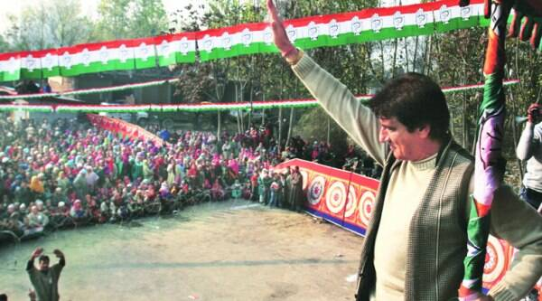 Raj Babbar waves to his audience in Hajin, where he campaigned for Imtiaz Parray on Tuesday.(Source: Express photo by Shuaib Masoodi)