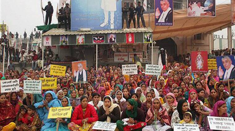 Women followers sheild the Satlok Ashram of Sant Ram Pal in Hisar on Wednesday after the news of police approaching it. (Source: PTI)