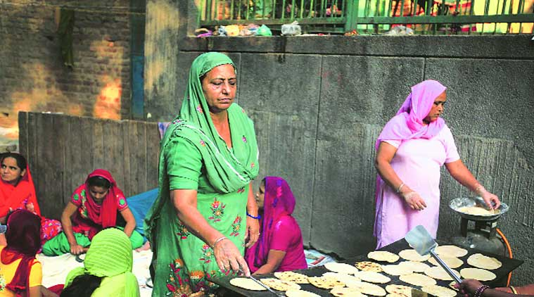 Women from the locality prepare food for the last day of prayer meeting held in memory of the victims. (Source: Express photo byOINAM ANAND )