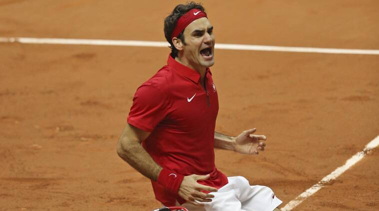 Roger Federer reacts after beating Richard Gasquet 6-4, 6-2, 6-2 to give Switzerland an unassailable 3-1 lead in the Davis Cup finals (Source: AP)