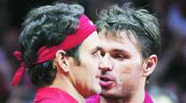 Federer, Wawrinka's double act puts Swiss on the verge