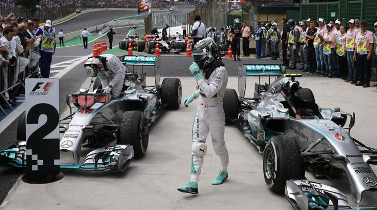 Mercedes Formula One driver Nico Rosberg of Germany celebrates as he steps out of his car after winning the Brazilian Grand Prix (Source: Reuters)