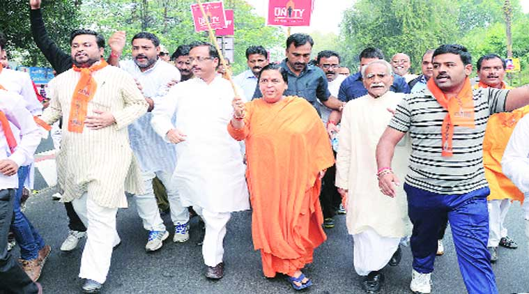 BJP leader Uma Bharti participates in 'Run for Unity' on the occasion of Sardar Vallabhbhai Patel's birth anniversary, in Lucknow on Friday.