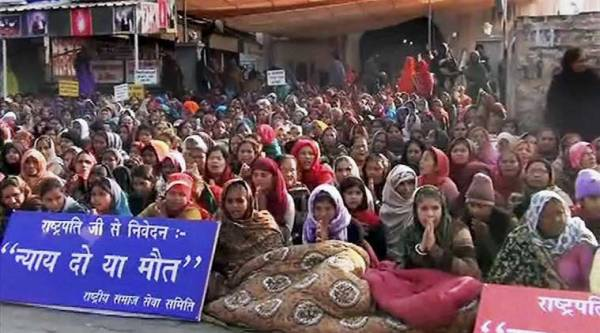 Women followers sheild the Satlok Ashram of Sant Ram Pal in Hisar on Sunday after the news of police approaching for the arrest of Sant Ram Pal. (PTI Photo)