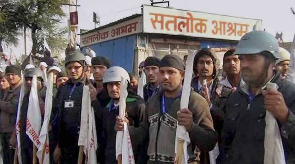 Followers sheild the Satlok Ashram of Sant Ram Pal in Hisar on Sunday after the news of police approaching for the arrest of Sant Ram Pal. (PTI Photo)