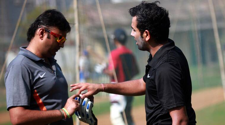 In this file picture taken three weeks ago, Physio Vaibhav Daga examines Rohit's injured finger. (Source: Express FILE)