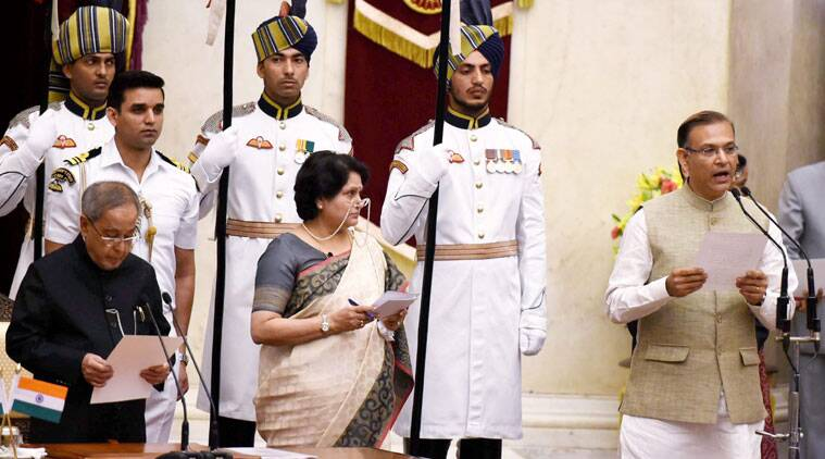 President Pranab Mukherjee administers oath to new Minister of State Jayant Sinha at the swearing-in ceremony at Rashtrapati Bhavan in New Delhi on Sunday. (Source: PTI)