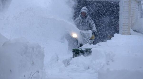 Several feet of lake-effect snow paralyzed the Buffalo area. (Source: AP photo)
