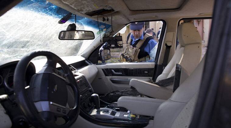 A policeman looks a damaged car at the site of a suicide attack in Irbil, capital of the semi-autonomous Kurdish region in northern Iraq that took place near the city's historic citadel on Wednesday, Nov. 19, 2014. The bomber struck in the heart of the northern Iraqi Kurdish city, killing several people, according to initial reports in local Kurdish media.(Source: AP)
