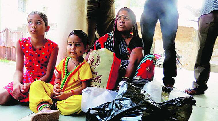 Nem Bai's children wait for her body outside the mortuary of the Chhattisgarh Institute of Medical Sciences. (Source: Express photo by Ashutosh Bhardwaj)
