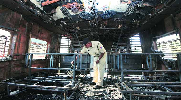 The charred coach. The fire was reported at 1.10 pm and it took the fire personnel 30 minutes to douse the flames. No one was injured. (Source: Express photo by Deepak Joshi)