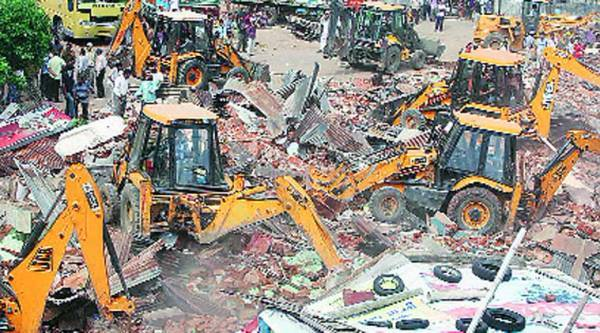 VMC undertook a major demolition drive in Fatehgunj area on Sunday.  (Express photo by Bhupendra Rana)