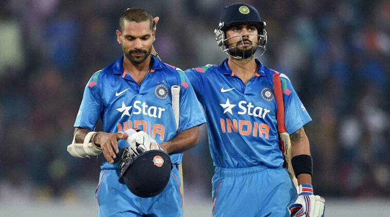 Indian batsman Shikhar Dhawan returns pavilion as Virat Kohli pats him during 3rd ODI against SriLanka at Hyderabad on Sunday. (Source: PTI)