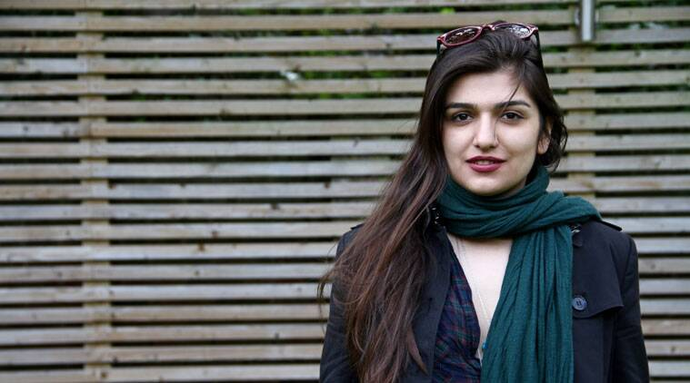 "This 2012 photo provided by the Free Ghoncheh Campaign, shows Iranian-British Ghoncheh Ghavami posing for a photograph in London, England. Ghavami detained while trying to attend a men's volleyball game has been sentenced to one year in prison, her lawyer said Sunday, Nov. 2, 2014. Mahmoud Alizadeh Tabatabaei told The Associated Press that a court found Ghavami, 25, guilty of ""propagating against the ruling system."" (Source: AP)"