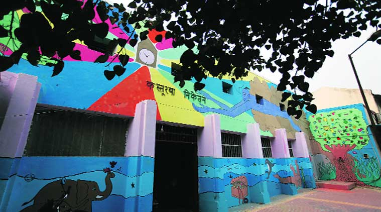 Murals of football heroes, a couple in the sea are among the paintings created by 16 boys at the home (above) in Lajpat Nagar. (Source: Express photo by Oinam Anand)