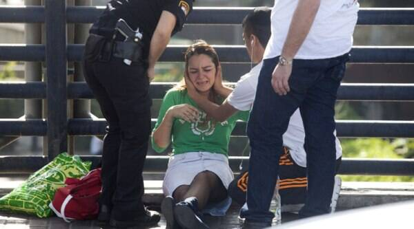 Paramedics treat a woman for shock after a soldier was stabbed in Tel Aviv, Israel, on Monday. (Source: AP photo)