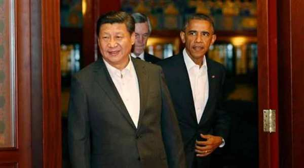 Barack Obama, right, follows China's President Xi Jinping as they enter a room for a meeting after participating in the Asia Pacific Economic Cooperation summit at the Zhongnanhai leadership compound in Beijing Tuesday, Nov. 11, 2014. (AP Photo)