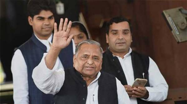 Samajwadi Party chief Mulayam Singh Yadav with party MPs during the first day of the winter session of Parliament in New Delhi on Monday.  (PTI Photo)