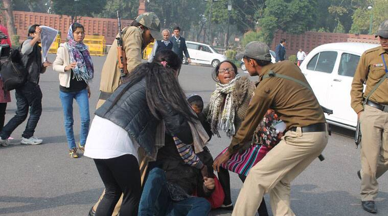 Acid attack survivors and volunteers being dragged by the police outisde Parliament. (Source: Stop Acid Attacks' Facebook page)