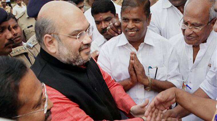 JP workers welcoming to party national president Amit Shah before a party meeting at Palakkad in Kerala on Friday. (Source: PTI)