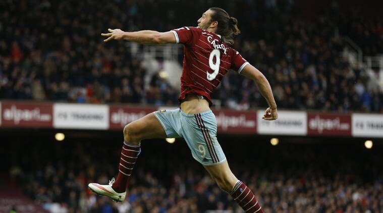 West Ham's Andy Carroll celebrates after scoring his team's second goal (Source: AP)