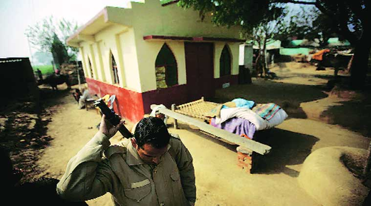 Security deployed at the church in Asroi. (Source: Express photo by Praveen Khanna)