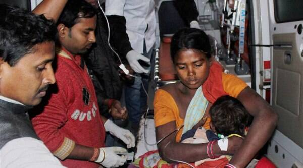 An injured woman and her child being rushed to hospital in Sonitpur, Assam on Tuesday night. Many people were killed after heavily armed NDFB(S) militants attacked Adivasi settlers. (source: PTI Photo)