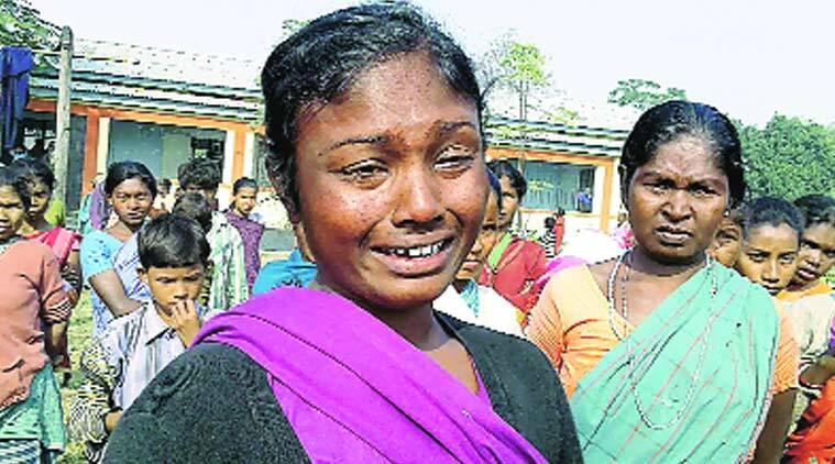 A violence-affected tribal woman breaks down at a relief camp in Kokrajhar Saturday. (Source photo: PTI)