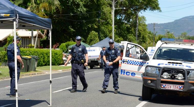 Police patrolled near a house where eight children were found dead in a Cairns suburb in far north Queensland, Australia. (Source: Associated Press)