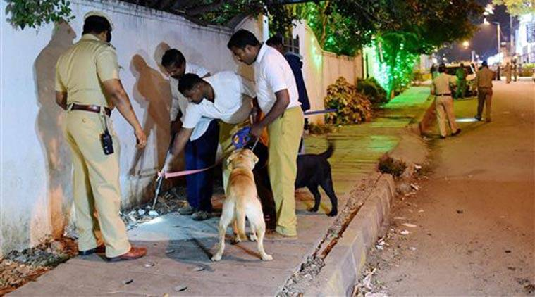 Sniffer Dog squad on spot where a low intensity bomb blast occurred at church street in Bangalore. (Source: PTI)