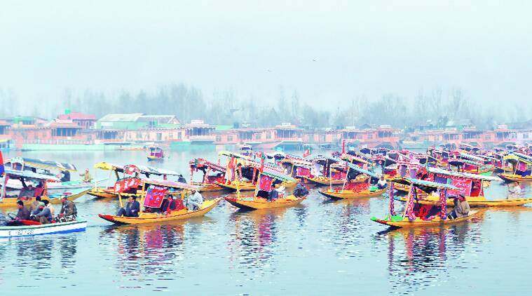 A shikara rally on the Dal Lake, taken out by BJP workers to welcome Modi. (Source: Express photo by Shuaib Masoodi)