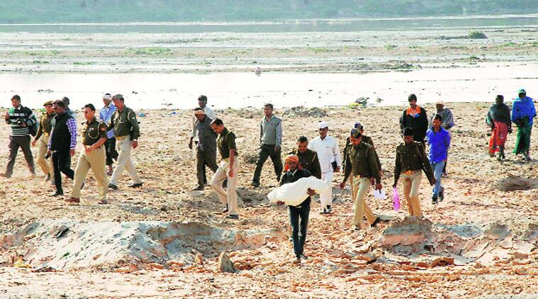 Police exhumed the body from the banks of the Yamuna on Saturday. (Source: Express photo by Gajendra Yadav)