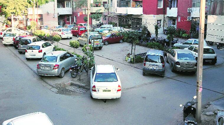 Vehicles parked along the roads in Sector 44, Chandigarh, on Tuesday. (Source: Express photo by Jasbir Malhi)