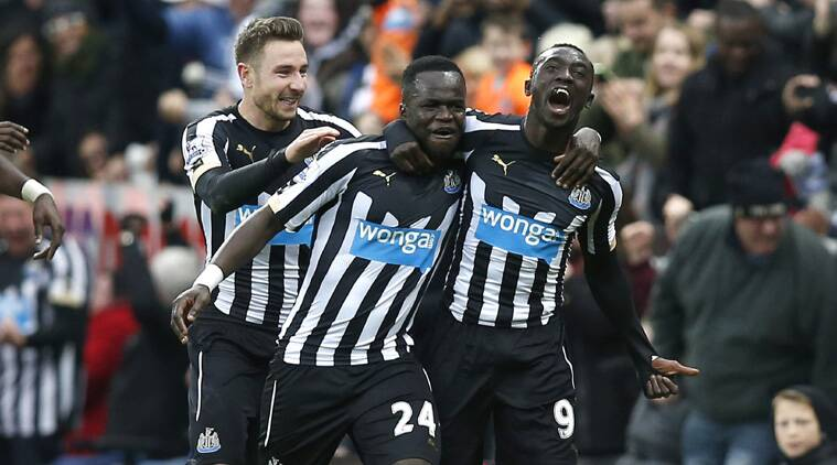Demba Cisse celebrates his goal with Ismael Tiote,  Cisse now has 7 goals in 9 games for the magpies. (Source: Reuters)