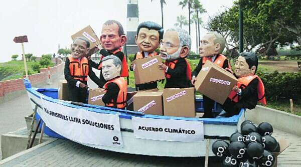 Activists wear masks of world leaders during a demonstration demanding cuts in global emission at the UN Climate Change Conference in Lima on Friday.
