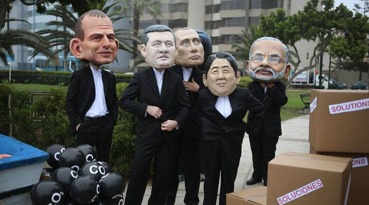 Environmental activists wearing puppet faces representing, from left, Australia's Prime Minister Tony Abbott, Canada's Prime Minister Stephen Harper, Russia's President Vladimir Putin, Japan's Prime Minister Shinzo Abe and India's Prime Minister Narendra Modi perform during the Climate Change Conference COP20 in Lima. (Source: AP)