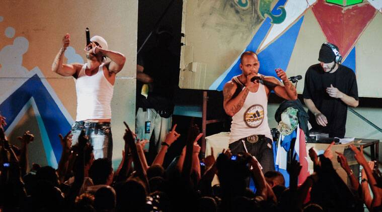 Members of Los Aldeanos, Aldo Rodriguez, left, and Bian Rodriguez, center, perform in concert at the Acapulco Theater in Cuba. (Source: AP photo)