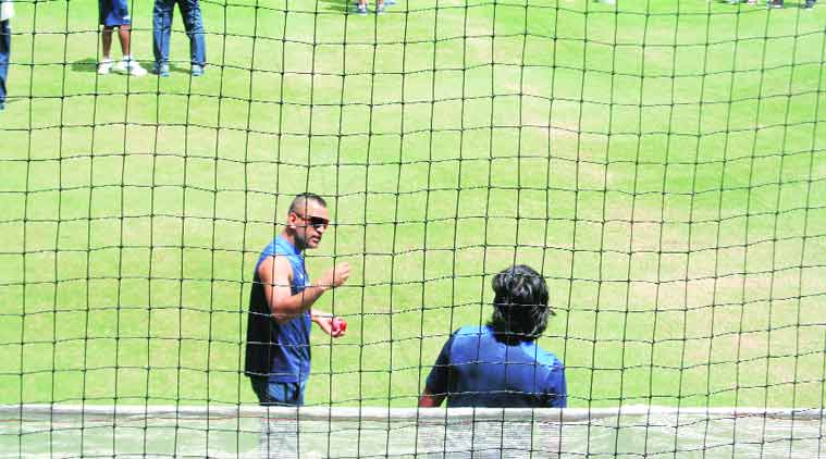 Mahendra Singh Dhoni speaks with Ishant Sharma during the nets at the Adelaide Oval on Sunday. (Source: Express photo by Bharat Sundaresan)