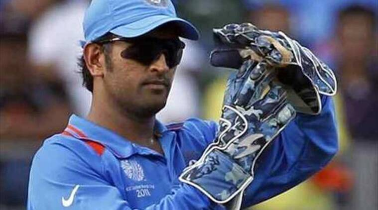 Army green and navy blue were the predominant colours in MS Dhoni's wicket-keeping gloves.