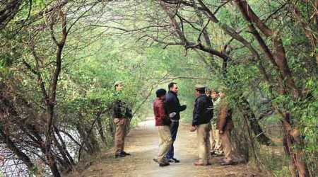 Police officers visited the spot in the Sector-54 park, where the woman's body was found.	(Source: Gajendra Yadav)