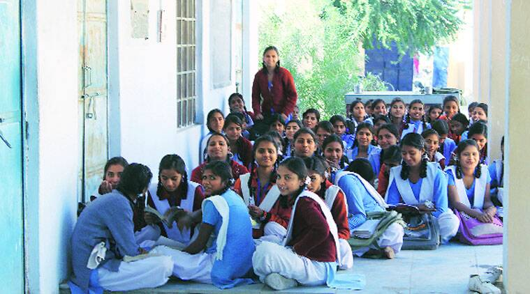 Students wait for a teacher in the school corridor. ( Source: Express photo by Shrenik mutha)