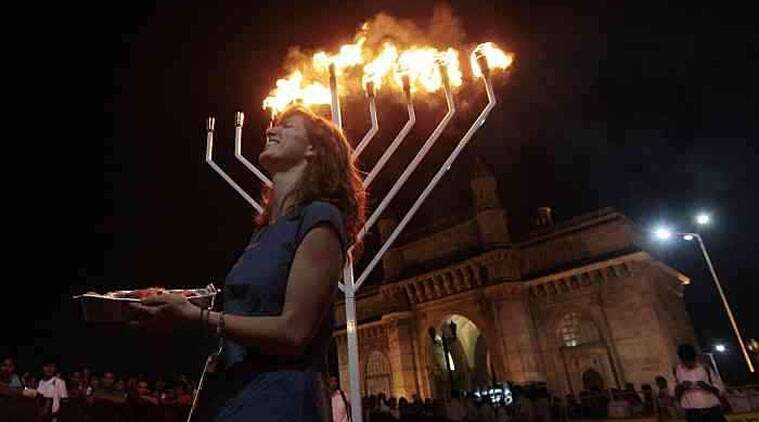 This year's public celebration of lighting of the Menorah took place at the Gateway of India in Mumbai lead by Rabbi Israel Kozlovsky. (Source: AP photo)