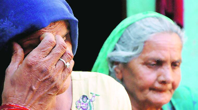 Family members of accused Kuldeep at their Aasan village residence on Monday. (Express photo by Gajendra Yadav)