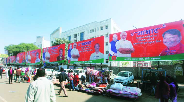 Hoardings of Narendra Modi, Amit Shah and state BJP leaders in Jharkhand Wednesday, a day after results were announced.(Source: Express photo by Partha Paul)
