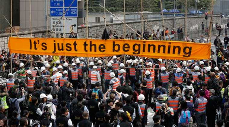 Workers clear barricades at the occupied area outside government headquarters in Hong Kong on Thursday (Source: AP)