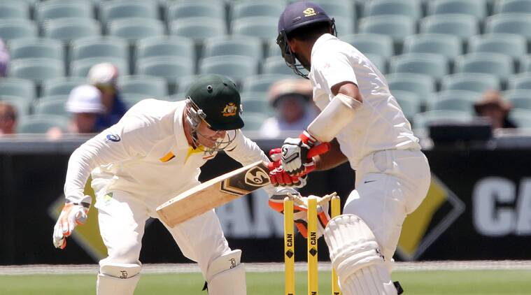 Cheteshwar Pujara sees the ball roll back on to his stumps. Pujara was out after scoring a solid 73. (Source: AP)