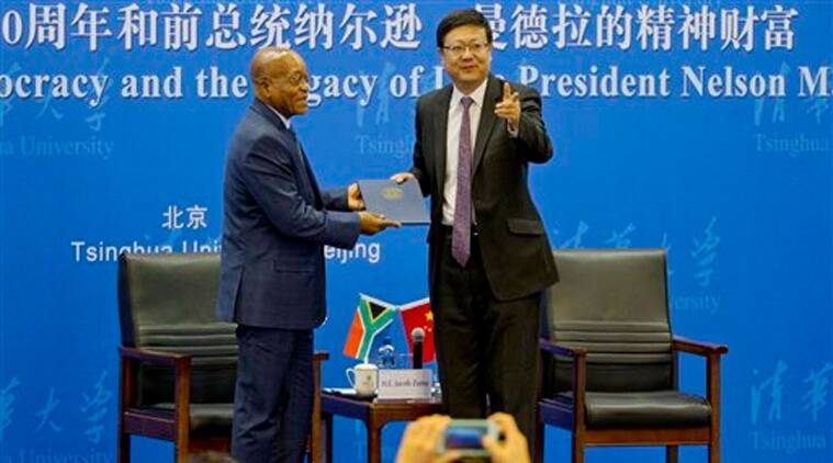 South African President Jacob Zuma attends a ceremony where he is conferred an honorary professorship at an auditorium in Tsinghua University in Beijing, China, Friday, Dec. 5, 2014. (Source: AP)