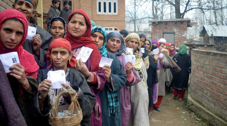 Kashmiri women stand in a long queue as they wait to cast their vote at in a polling station at Shangus in south Kashmir's Anantnag district on Sunday. (Source: PTI photo)