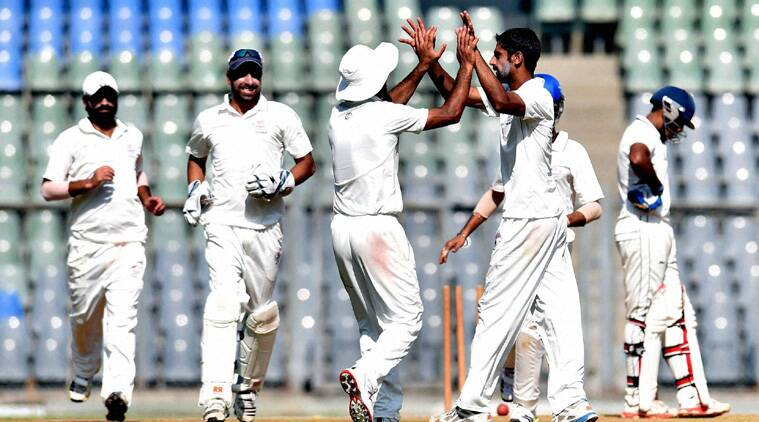Jammu and Kashmir players celebrate a wicket in their Ranji Trophy contest against  Mumbai (Source: PTI)